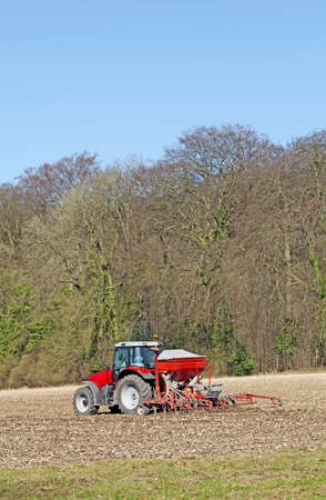 Tractor preparing the field for the spring crop