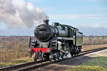 Steam train working backwards towards the station to pick up its next duty coaches photo