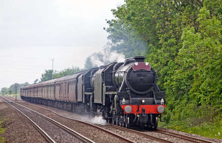 Two mainline steam trains on an express service through a rural location Stock Photo - 9599295