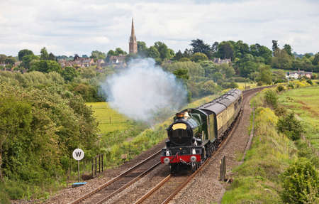 Old steam locomotive taking passengers through gentle rolling countryside Stock Photo - 9599296