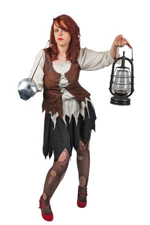 female pirate: Young woman dressed in pirates costume with sword and lamp in hand Stock Photo