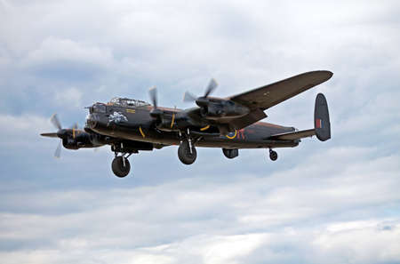 Farnborough, United Kingdom - July 24 2010. Avro Lancaster bomber coming into land after giving an aerial display at the bi-annual Farnborough airshow