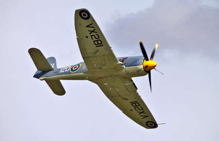 shuttleworth: Old Warden, United Kingdom- August 2011. Fighter plane Sea Fury of the Royal Navy Historic flight gives an aerial display at the Mid Summer air gala held by the Shuttleworth collection on  August 7, 2011 Editorial