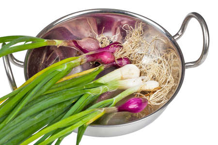 bulb and stem vegetables: Red and white spring onions in a chromium plated serving bowl