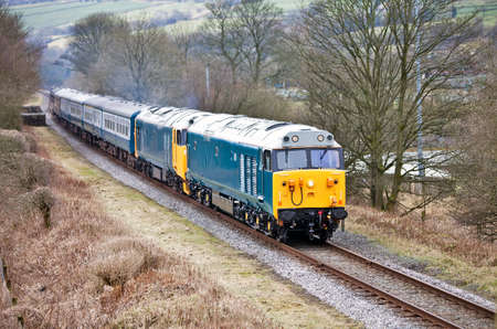 double headed: Double headed diesel passenger train running on a preserved stretch of railway track