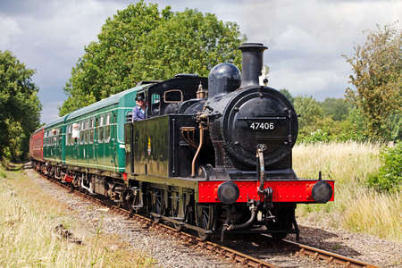 July 17 2011. Mid Norfolk Railway, United Kingdom, Yaxley. Class 3F loco, 47406, passes into Yaxley station as part of the Summer steam gala. This is the first time that the MNR has held a steam gala event since its conception. Stock Photo - 10770337
