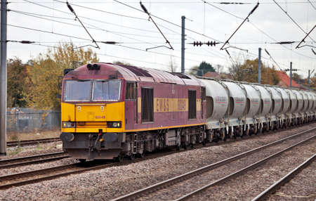 LEAGRAVE, UNITED KINGDOM - NOVEMBER 2010 - Diesel locomotive 60049 hauls a freight train of cement northbound on November 3, 2010 at Leagrave. The introduction by Hanson Cement (formerly Castle) of aluminium cement wagons saved a total of 5000 lorry journ Stock Photo - 10770203