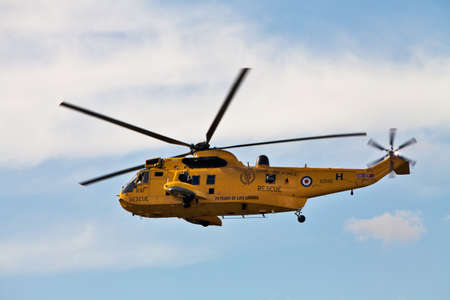 BENSON, UNITED KINGDOM - AUGUST 2011 - RAF Search and Rescue Sea King helicopter gives a demonstration of the Rescue procedure followed to pick up survivors at sea on August 25, 2011 at Benson air display.