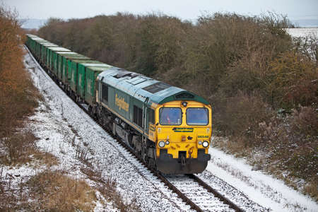 reprocessing: December 1, 2010 - Aylesbury, UNITED KINGDOM. Freight train passing north with London waste material for the reprocessing plant. Rail transports in excess of 900,000 tonnes of London's domestic waste per year.