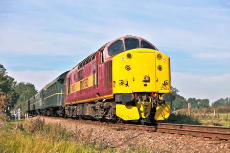 CASTOR, ENGLAND - OCTOBER 1: Preserved class 37 diesel (37503) takes passengers to Peterborough station during the Nene Valley Railway's autumn diesel gala on October 1, 2011 at Castor Stock Photo - 10868149