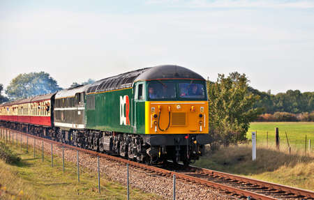 diesel locomotives: WANSFORD, ENGLAND - OCTOBER 1: Diesel locomotives from class 56 & 31 head a passenger excursion train from Wansford to Peterborough at the Nene Valley autumn diesel gala on October 1, 2011 at Wansford. Editorial