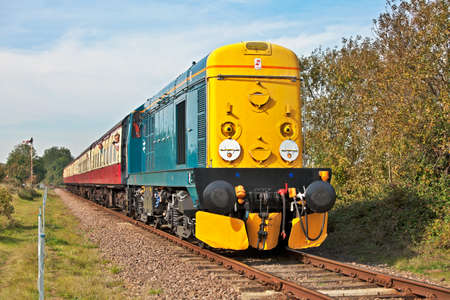 mainline: WANSFORD, ENGLAND - OCTOBER 1: Class 20 preserved diesel loco (20107) takes passengers to Peterborough during the NVR autumn diesel gala on October 1, 2011 at Wansford. Editorial