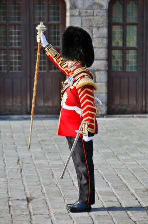 scots: YPRES, BELGIUM - SEPTEMBER 25: The Bandmaster of the Regimental Scots Guards band drops his staff to halt the marching bandsmen at the Ypres Military Tattoo on September 25 at Ypres. Editorial
