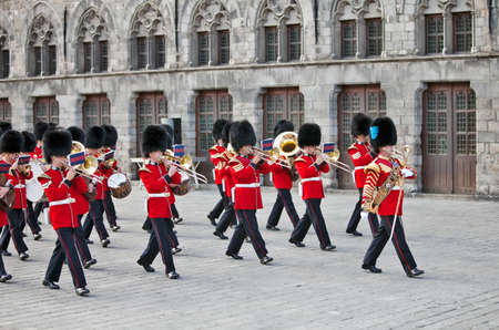 scots: YPRES,BELGIUM - SEPTEMBER 25: The Regimental Band of the Scots Guards perform in front of the Medieval Cloth Hall to a packed crowd at the Ypres Military Tattoo on September 25, 2011 at Ypres. Editorial