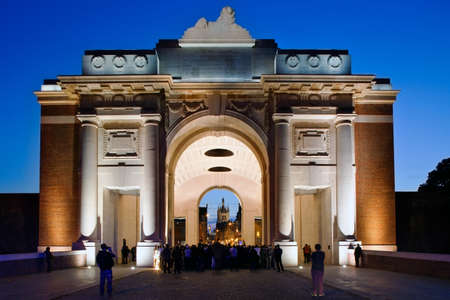 ypres: IEPER (YPRES), BELGIUM - SEPTEMBER 24: The Last Post is played under the Menin Gate by the Royal Scots Guards as a precursor to the opening of the Ypres Military Tattoo, on September 24, 2011 in Ypres, Belgium