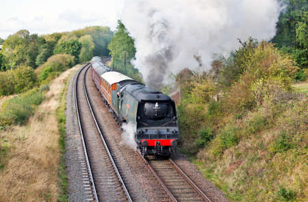 QUORN, ENGLAND - OCTOBER 7: Bulleid Light Pacific, Wadebridge, passes Kinchley Lane during the Great Central Railway Stock Photo - 10868157