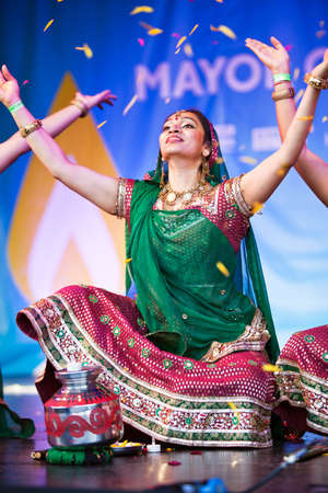 LONDON, OCTOBER 16: An unnamed Indian female dancer enters the stage at the beginning of her dance act at the Diwali Festival of Light in Trafalgar Square on October 16, 2011 in London. Editorial
