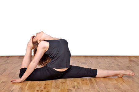 Flexible woman demonstrating advanced yoga positions Stock Photo