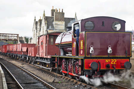WANSFORD, ENGLAND - APRIL 3: Industrial steam shunter, No 22 prepares to take a demonstration freight train to Peterborough during the NVR spring mixed traffic gala on April 3, 2011 at Wansford Stock Photo - 11259952