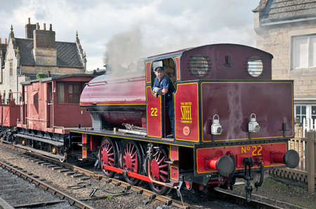 WANSFORD, ENGLAND - APRIL 3: Industrial steam shunter, No 22 prepares to take a demonstration freight train to Peterborough during the NVR spring mixed traffic gala on April 3, 2011 at Wansford Stock Photo - 11259946