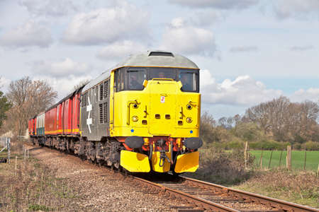 WANSFORD, ENGLAND - APRIL 3: Preserved diesel locomotive takes a demonstration TPO train to Peterborough for public viewing during the Nene Valley Railway spring diesel gala on April 3, 2011 at Wansford. Stock Photo - 11259951