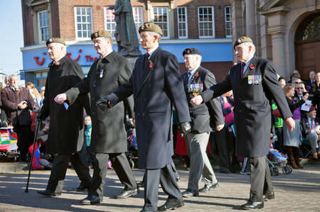 armistice: AYLESBURY, ENGLAND - NOVEMBER 13: Veteran soldiers from the Guards batallions lead out the walk past parade at the Armistice day ceremony on November 13, 2011 in Aylesbury, England. Editorial