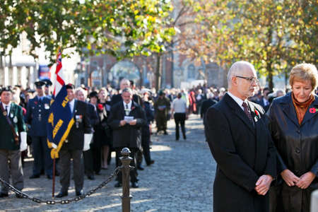 armistice: AYLESBURY, ENGLAND - NOVEMBER 13: Mourners pay their respects to the fallen at the Cross of Honour during the Armistice Day Parade on November 13, 2011 in Aylesbury
