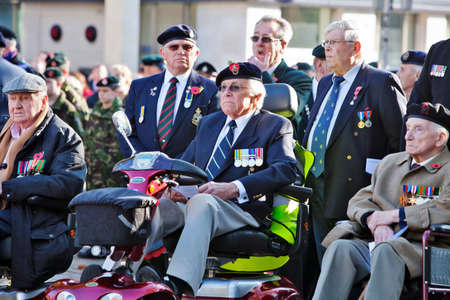 armistice: AYLESBURY, ENGLAND - NOVEMBER 13: War veterans from past conflicts take pride of place at the Armistice day ceremony on November 13, 2011 in Aylesbury Editorial