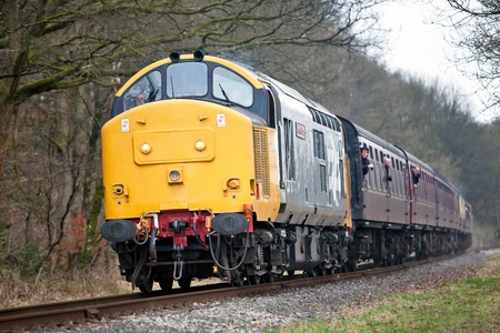 IRWELL, ENGLAND - MARCH 5: Preserved diesel locomotive, 37901, passes through the Irwell Valley with a passenger service train during the East Lancs spring diesel gala on March 5, 2011 at Irwell Stock Photo - 11440991
