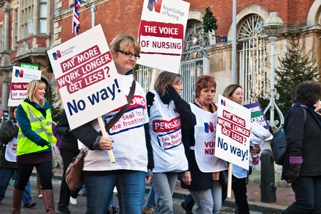 pension cuts: AYLESBURY, ENGLAND - NOVEMBER 30: Members of the Royal College of Nursing join in the general public service workers strike against proposed government pension cuts on November 30, 2011 in Aylesbury