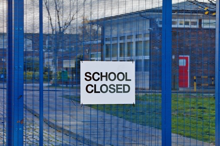 stating: AYLESBURY, ENGLAND - NOVEMBER 30: A simple sign stating School Closed sits on the main gates of Mandeville School as a result of industrial action by public sector workers on November 30, 2011 in Aylesbury