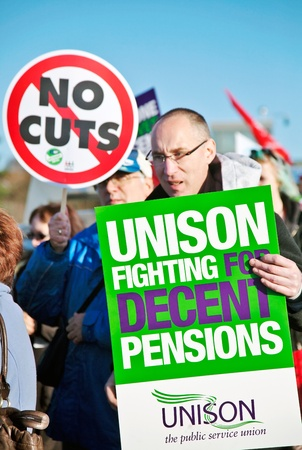 unison: AYLESBURY, ENGLAND - NOVEMBER 30: Civil Servants go on strike across the UK over planned Government reforms to the pension plan. A member of the union UNISON marching on November 30, 2011 in Aylesbury. Editorial