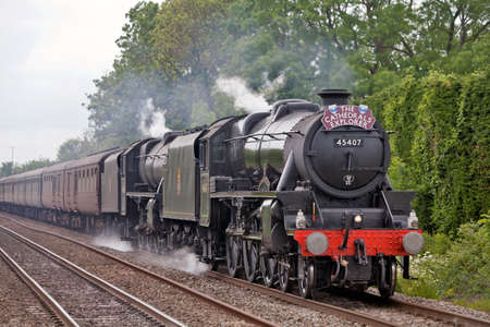 STEVENTON, ENGLAND - MAY 13: GB V enters the final stage of its week long national tour of the UK headed by two Stanier Black 5 steam locomotives on May 13, 2011 at Steventon.