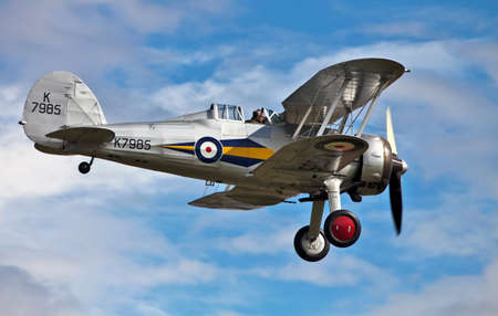 OLD WARDEN, ENGLAND - AUGUST 7: A Gloster Gladiator fighter plane makes its landing approach after giving an aerobatics display at the Shuttleworth Summer air gala on August 7, 2011 at Old Warden