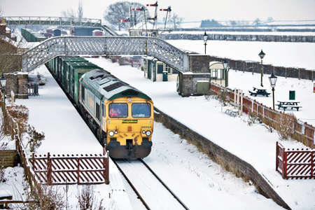 QUAINTON, ENGLAND - DECEMBER 22: A domestic waste train passes the disused station at Quainton en-route to the recycling plant on December 22, 2010 at Quainton. Rail transports in excess of 900,000 tonnes of London�s domestic waste per year Stock Photo - 11887331