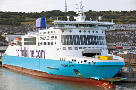 DOVER, ENGLAND - JULY 19: Norfolk line ferry, Maersk Delft sits beneath the Dover Cliffs in port on July 19, 2010 in Dover. On route for delivery she was attacked by armed pirates in speedboats in the Gulf of Aden