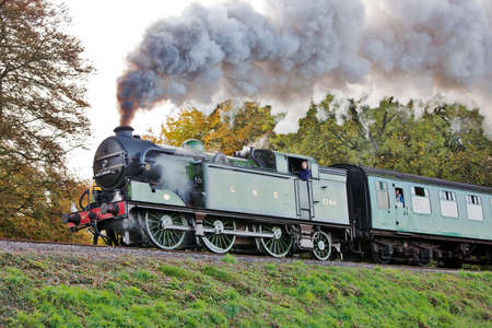 hants: ROPLEY, ENGLAND - OCTOBER 29: Guest loco GNR 1744 passes into Wanderers curve with a passenger train at the Mid Hants Railway autumn steam gala on October 29, 2011 at Ropley