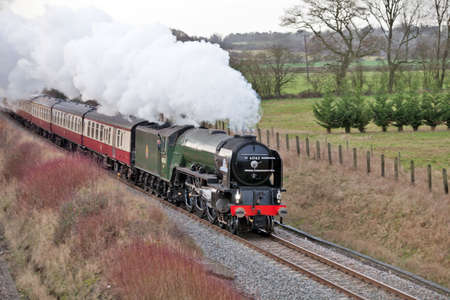 SAUNDERTON, ENGLAND - DECEMBER 30: Steam loco, 60163, Tornado takes the William Shakespeare express train from London to Stratford on an excursion special on December 30, 2011 at Saunderton. Stock Photo - 11887330