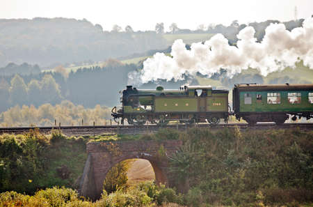 ALRESFORD, ENGLAND - OCTOBER 28: Ex GNR steam locomotive 1744 passes along Ropley embankment with a train of passengers at the Mid Hants Railway autumn steam gala on October 28, 2011 at Alresford Stock Photo - 12059721