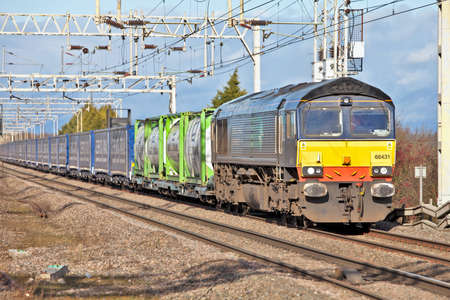 CHEDDINGTON, ENGLAND - JANUARY 19: A Tesco freight train heads towards Thurrock on January 19,2012 at Cheddington. Tesco the largest supermarket chain in the UK has introduced two new freight services replacing 40,000 road journeys p.a Stock Photo - 12201151