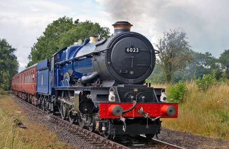 YAXLEY, ENGLAND - JULY 17: Ex GWR, King Edward II steam locomotive passes into Yaxley station at the Mid Norfolk Railway