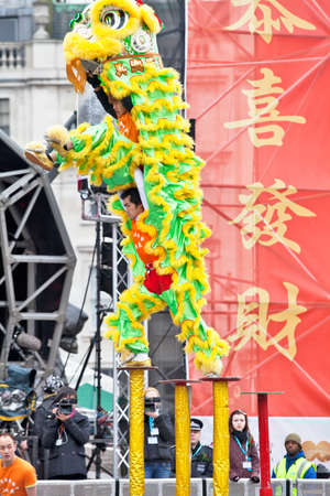 LONDON, JANUARY 29: The Chen brothers perform a traditional Flying Lion dance at the Chinese New Year celebrations in Trafalgar Square on January 29, 2012 in London.
