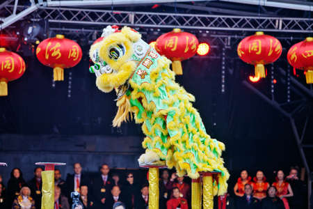 children acting: LONDON, JANUARY 29: The Chen brothers perform a traditional Flying Lion dance at the Chinese New Year celebrations in Trafalgar Square on January 29, 2012 in London.