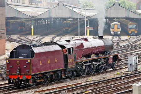 LONDON - MAY 6: Ex LMS steam locomotive Princess Elizabeth, 6201, reverses into London Victoria station to take charge of the Cathedrals Explorer special on May 6, 2011 in London Stock Photo - 12201160