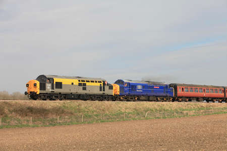 mainline: CROWNTHORPE, ENGLAND - MARCH 20: Two class 37 diesel locomotives take passengers on short pleasure trips through the Norfolk countryside at the Mid Norfolk spring diesel gala on March 20, 2011 at Crownthorpe