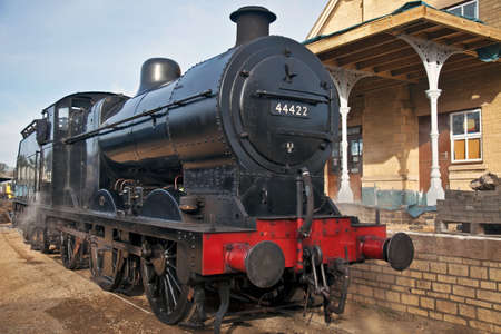 WANSFORD, ENGLAND - APRIL 3: Steam loco 44422 sits at the back of Wansford station waiting to take a passenger train to Peterborough during the Nene Valley Railway's autumn steam gala on April 3, 2011 at Wansford
