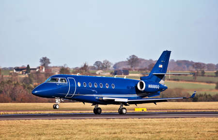 LUTON, ENGLAND - JANUARY 27: An IAI Gulfstream G200 business jet lands at Luton Int airport on January 27, 2012 at Luton. Production of the G200 ceased in December 2011 after 250 units being made. The G200 will now be replaced by the improved G280. Stock Photo - 12316207