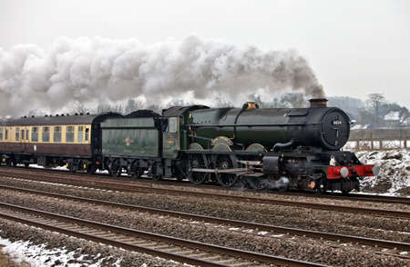 NORTH MORETON, ENGLAND - FEBRUARY 12: Steam loco, King Edward I, heads the London to Bristol Cathedrals Express special charter excursion on February 12, 2012 at North Moreton Stock Photo - 12316215