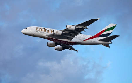 LONDON - FEBRUARY 19: An Emirates Airbus A380 flys over the boundary perimeter of Heathrow airport on February 19, 2012 in London. The Airbus A380 is currently the worlds largest passenger jet, accommodating up to 853 passengers
