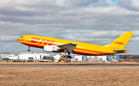 LUTON, ENGLAND - FEBRUARY 25: A DHL AirbusA300 cargo plane takes off from Luton airport on February 25, 2012 in Luton, England. DHL aviation, a division of DHL express operates a fleet of 75 aircraft worldwide